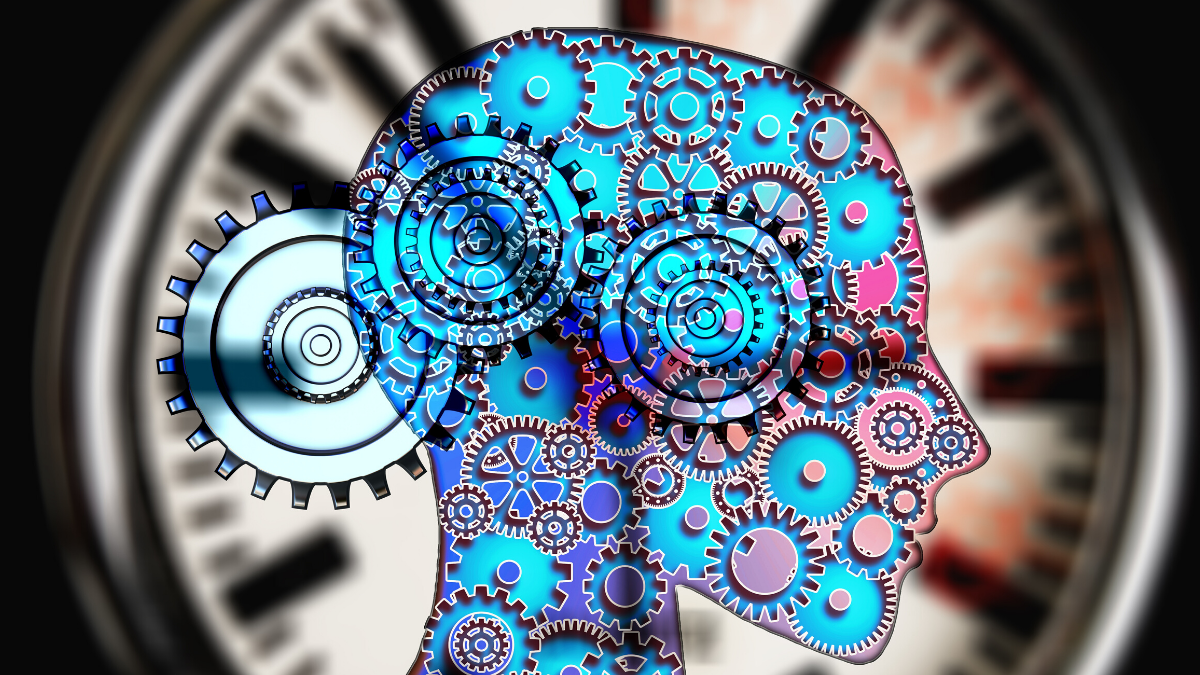 A picture of a head with purple and blue cogs to represent psychology