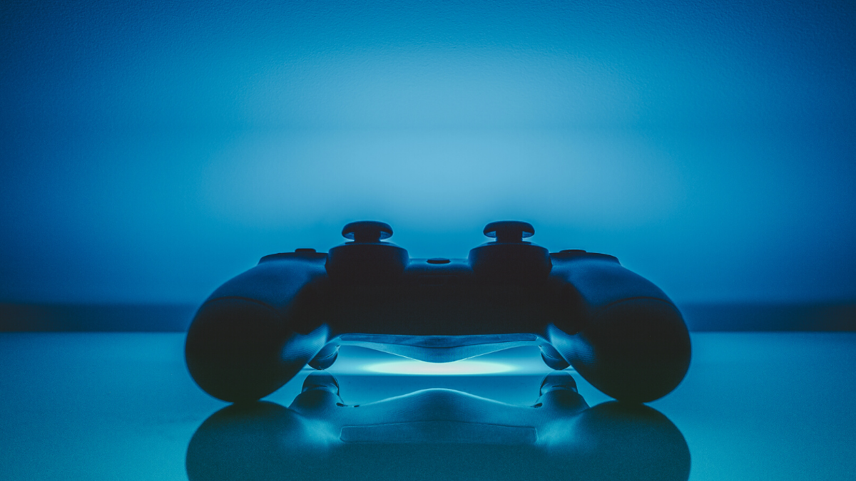 A picture of a game controller bathed in electric blue light to represent eSports betting.