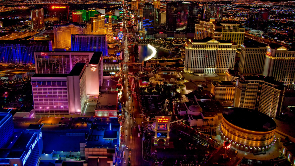 An ariel view of Las Vegas at night - bright lights and neon.