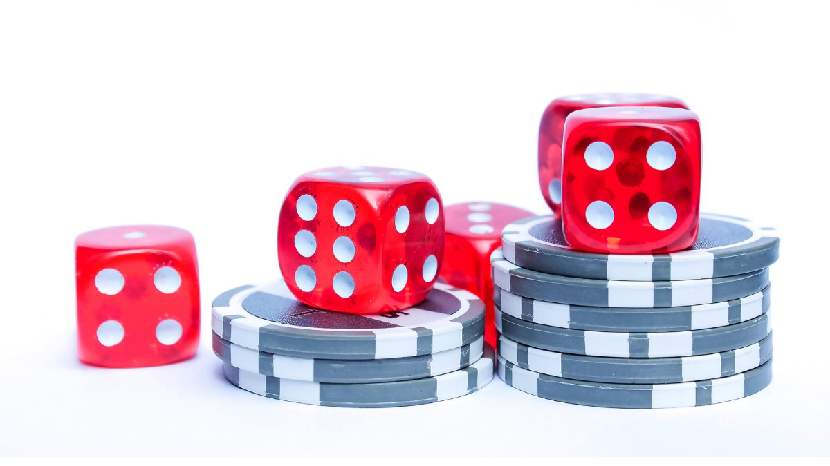 Dice and chips to represent gambling too much