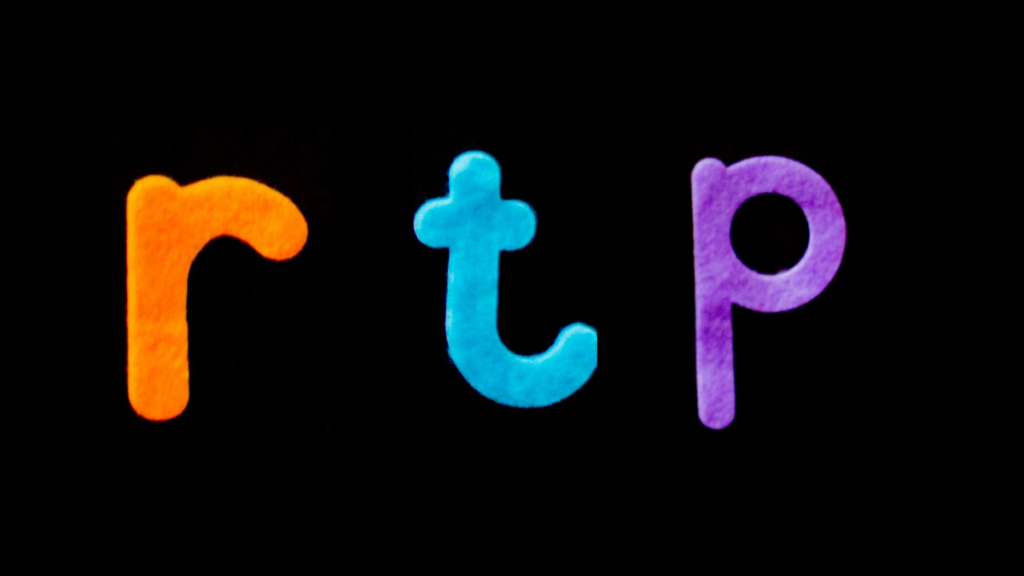 The letters 'RTP' in pretty colours to represent the RTP for online casinos