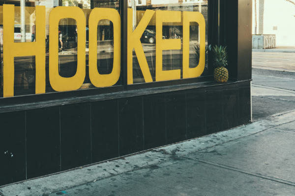 "A picture of signage in a window that says, ""hooked"""