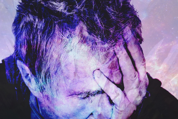 A man with his head in his hands. I used this image because it shows regret and this article is about making mistakes. The picture of the man is a bit of an arty rendition and has colour splashed over it.