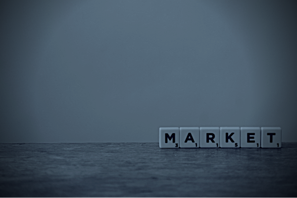 "A picture of ""market"" written in scrabble letters and in black and white. To represent black market."