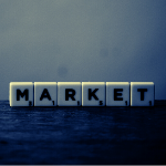 """A picture of scrabble letters saying """"market"""" in black and white to represent that it's a black market."""