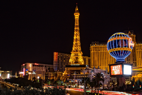 A picture of Las Vegas Casinos at night, with Paris Las Vegas at the forefront. You can see the Eiffel tower building in the middle - it's the most prominent part of the picture.