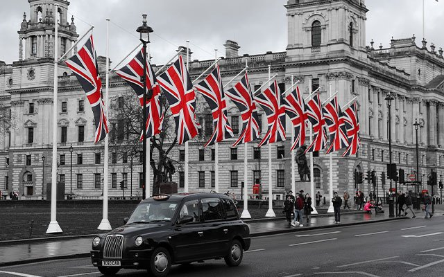 The UK flags and a taxi passing by