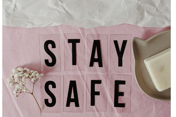 "An image that says ""Stay Safe"" in an arty way - it's black lettering on pink tissue paper."