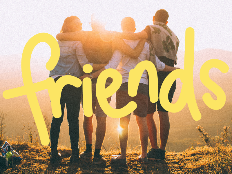 """A photo of four friends with their arms around each other's shoulders looking out over a valley at sunset. The word """"friends"""" is overlaid on the picture."""