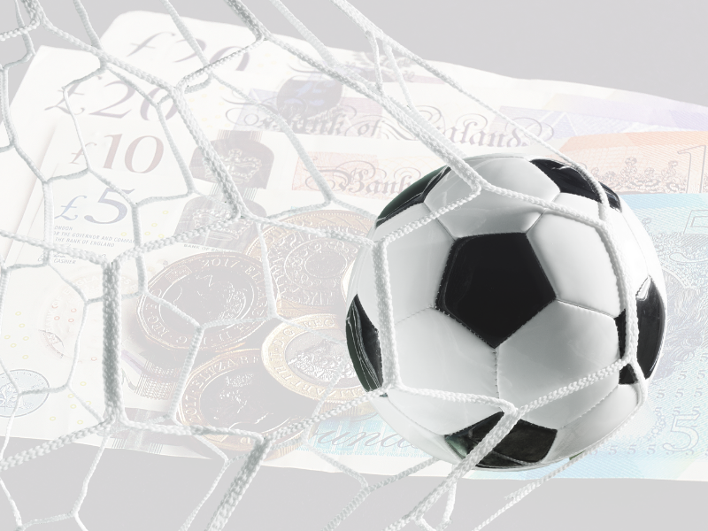 A picture of a football (OK fine - soccer ball) hitting the back of the net with a background that's highly transparent and shows UK bank notes.